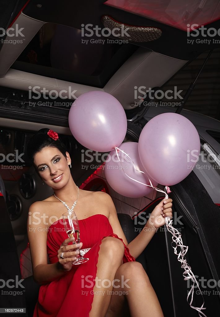 Attractive female in red smiling royalty-free stock photo