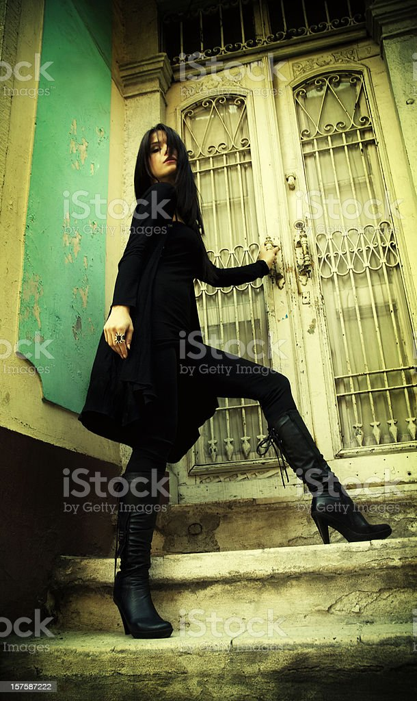 Attractive female in the old house stock photo