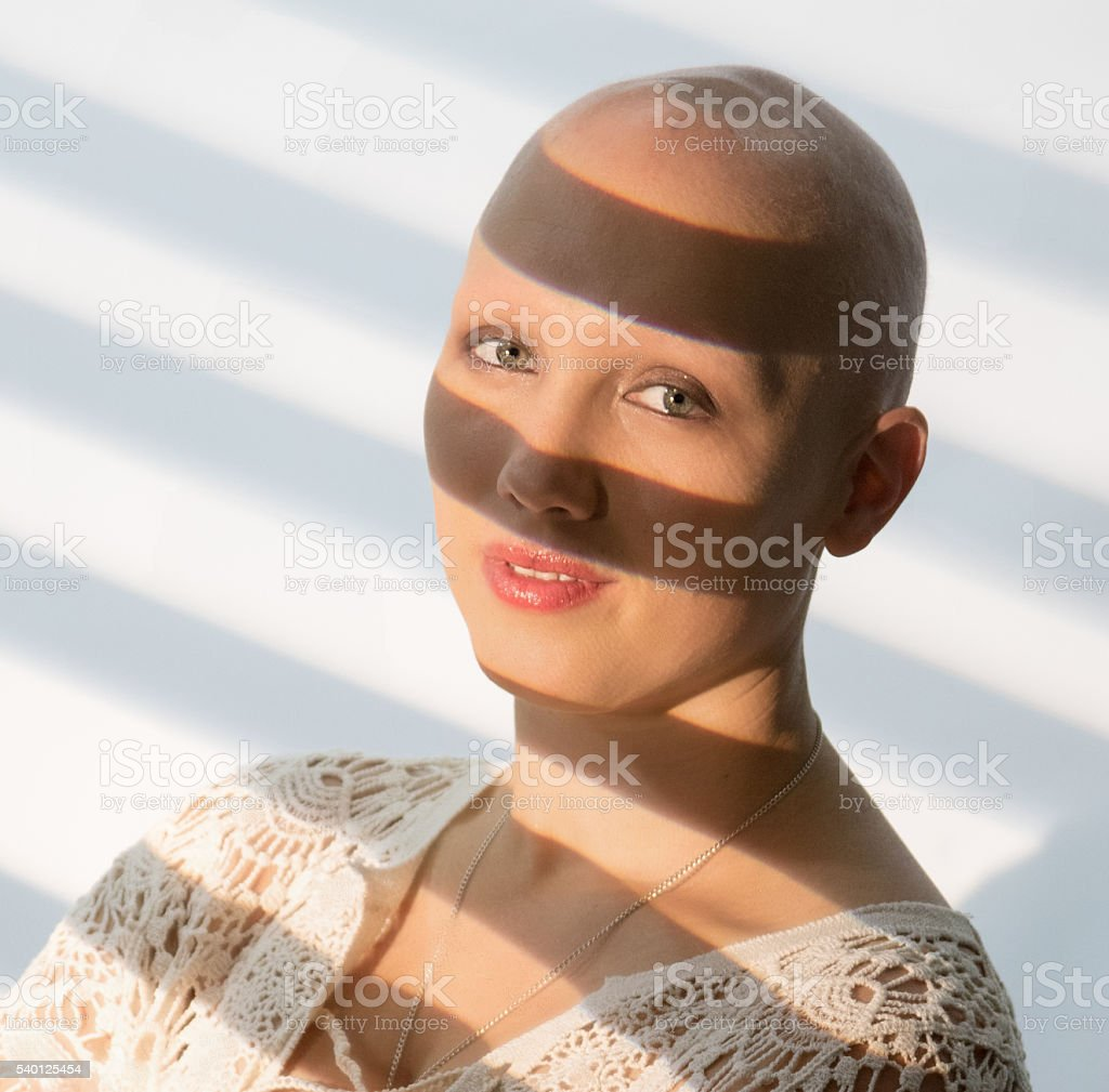 Attractive Female In The Shadows stock photo