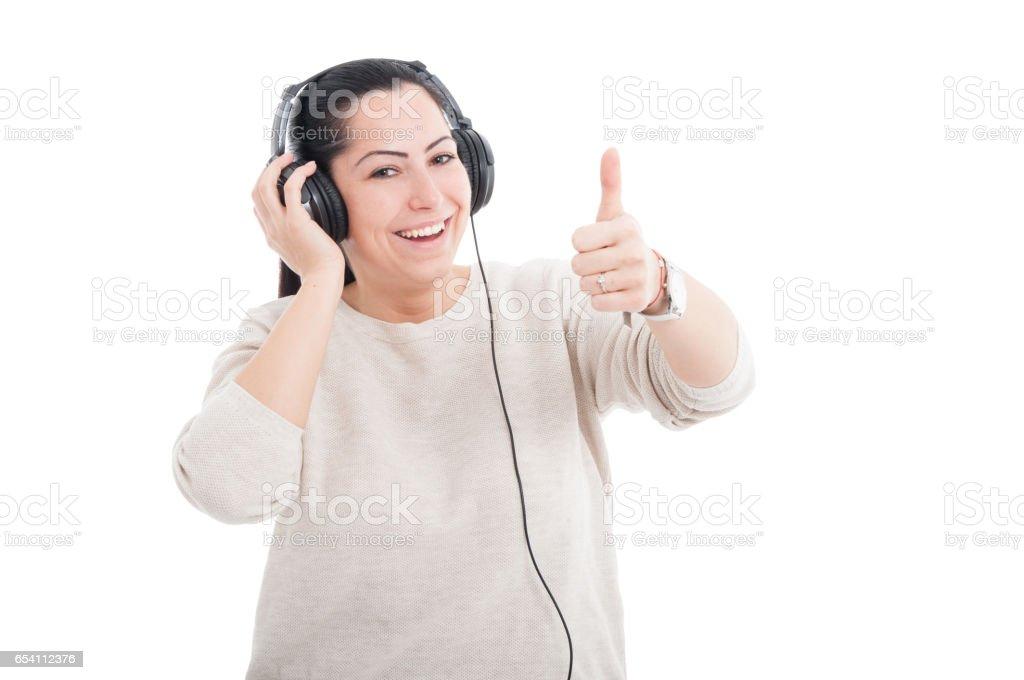 Attractive female listening music on earphones stock photo
