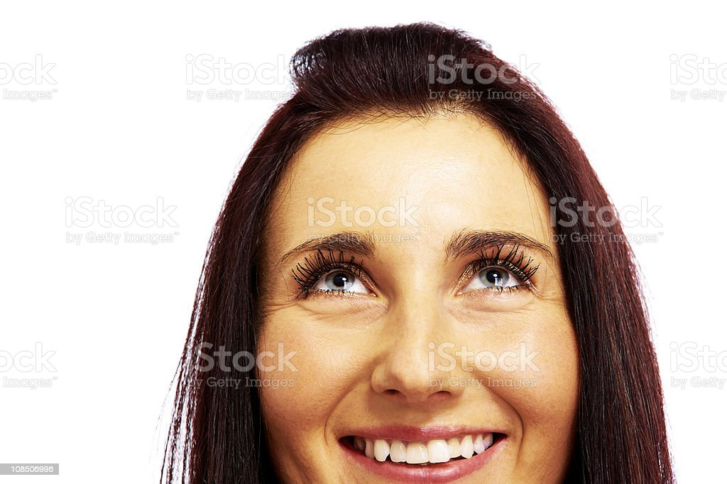 attractive female looking above her head over white royalty-free stock photo