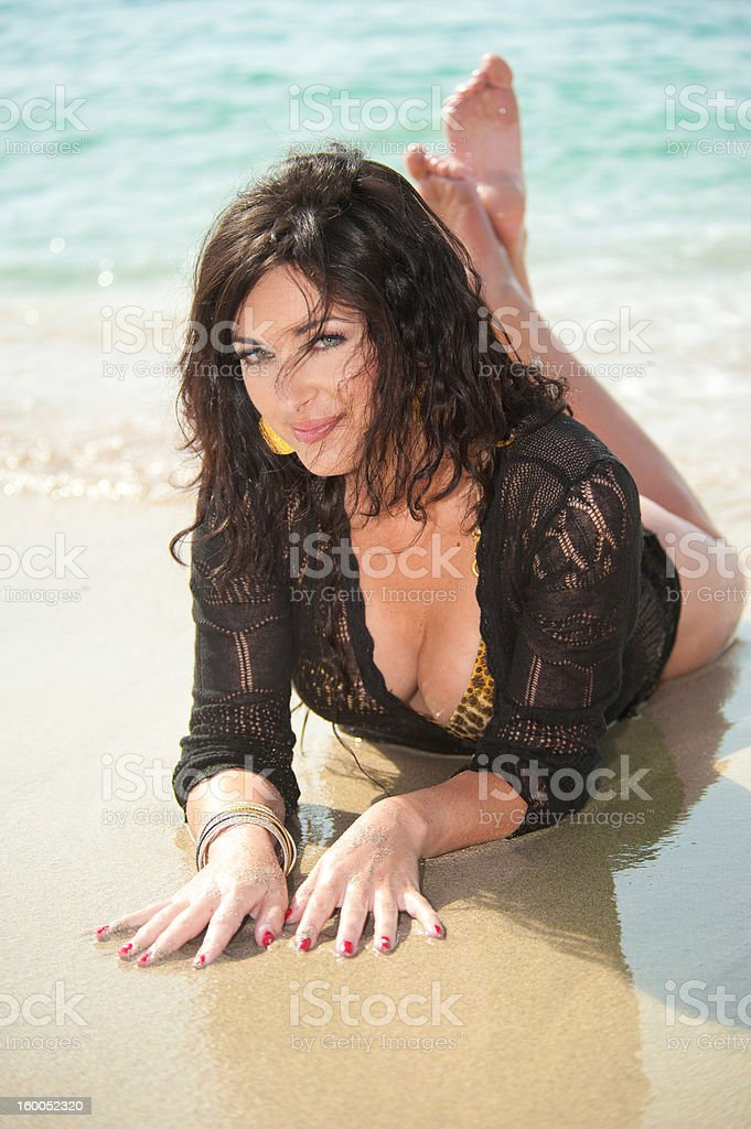 Attractive female relaxing on a sandy beach royalty-free stock photo