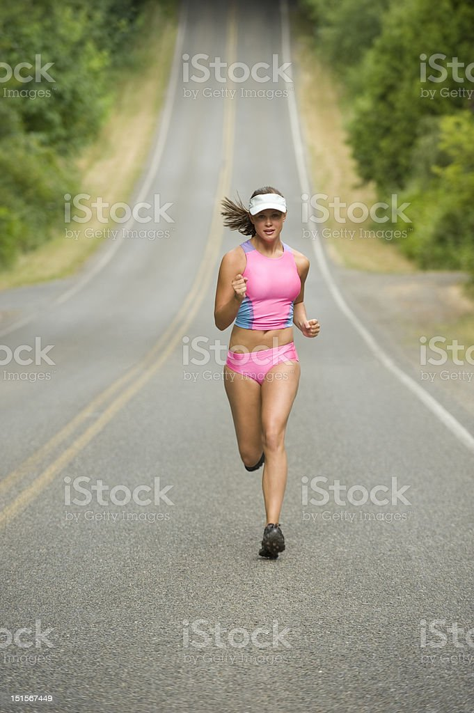 Attractive Female Runner on Country Road stock photo
