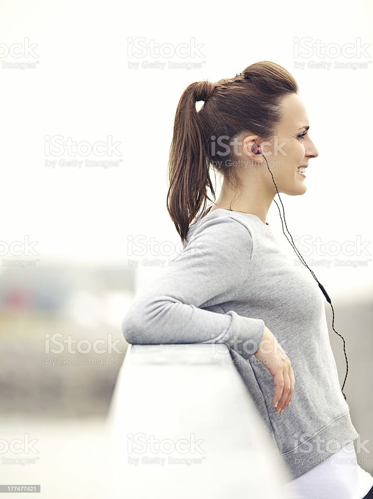 Attractive Female Runner Relaxing royalty-free stock photo