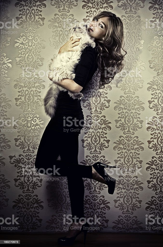 Attractive female with cat royalty-free stock photo