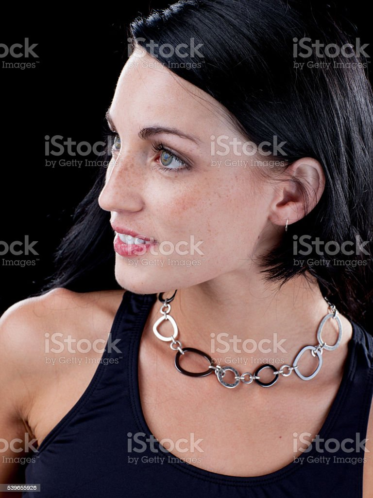 Attractive fit female portrait on black background stock photo