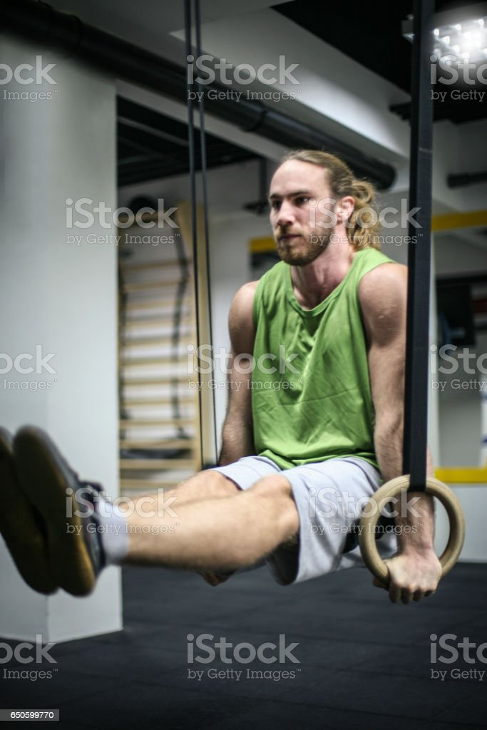 Attractive fit man working out at the gym. stock photo