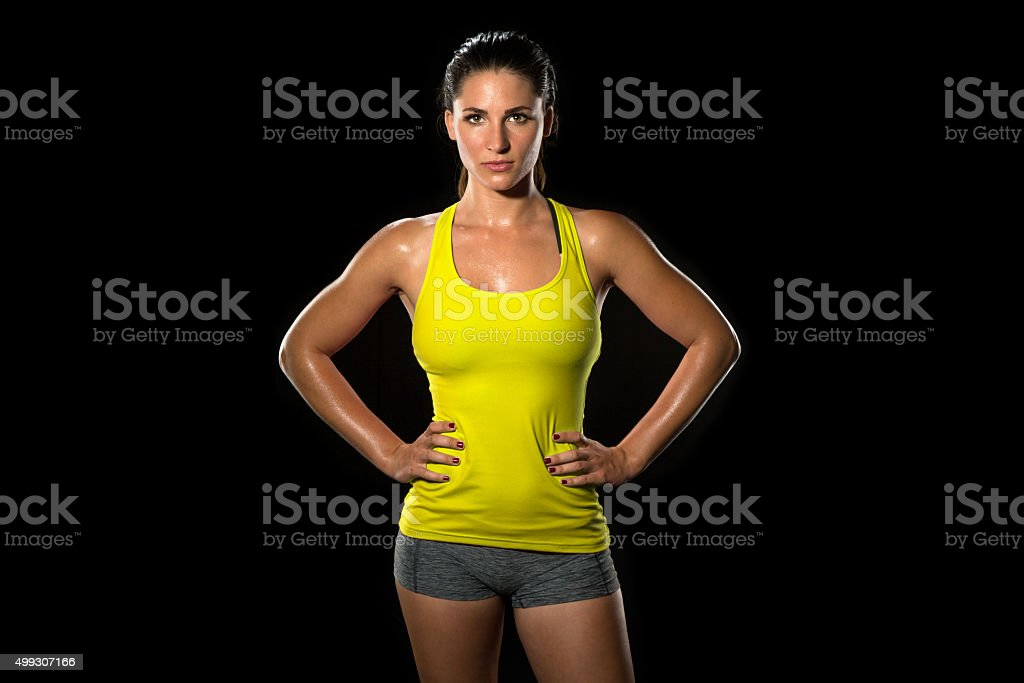 Attractive fit thin slim toned female body athlete confidently pose stock photo