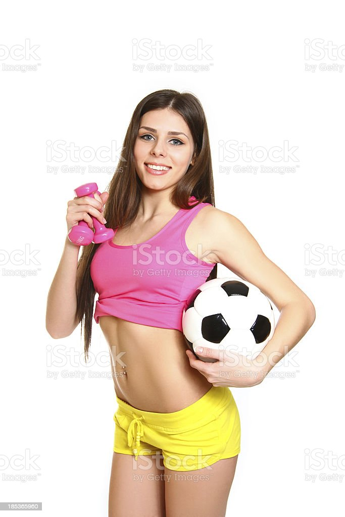 Attractive fitness girl with dumbbells and soccer ball on white royalty-free stock photo