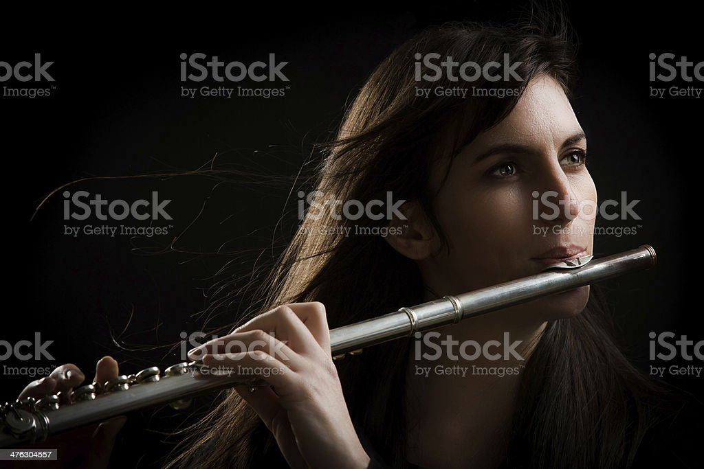 Attractive Flute Player stock photo