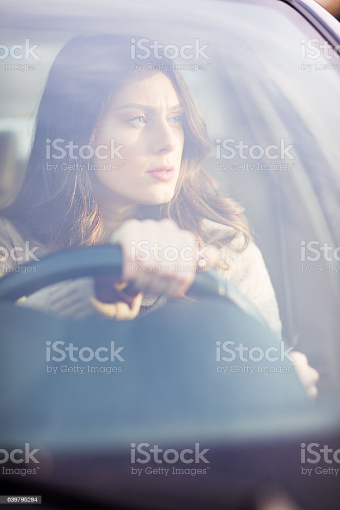 Attractive girl driving car stock photo