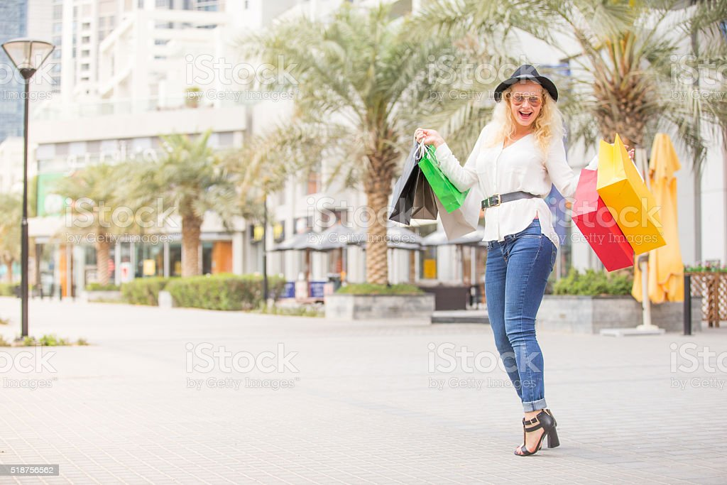 Attractive Girl Holding Her Shopping Bags stock photo