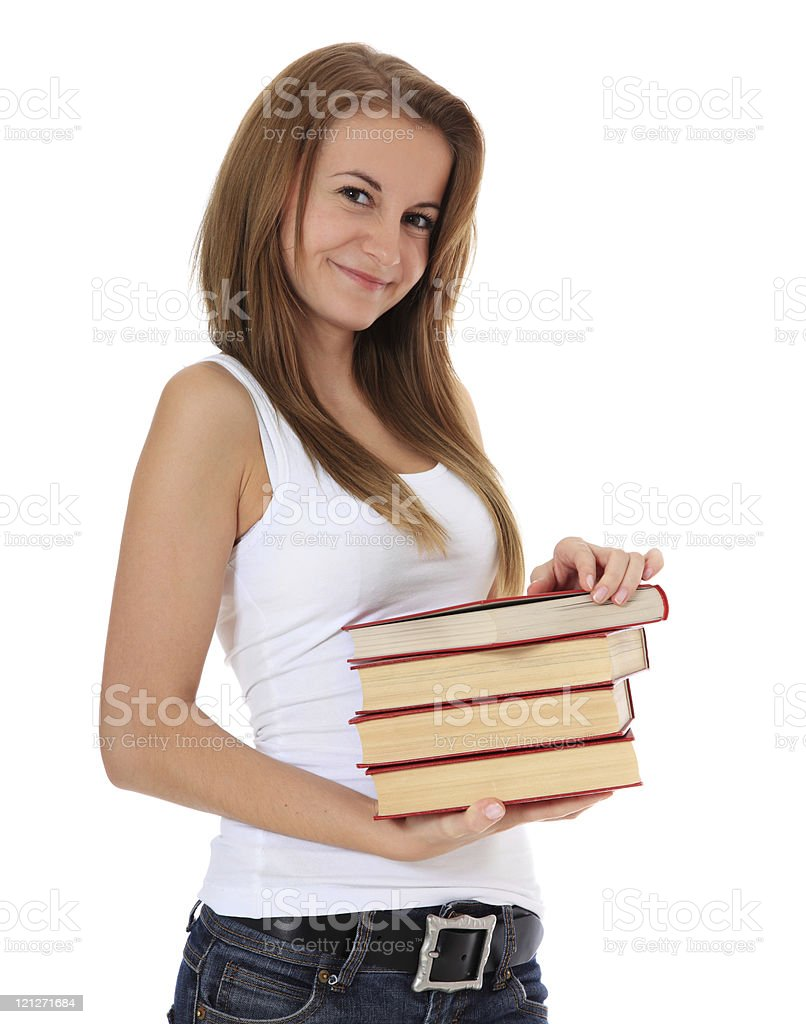 Attractive girl holding pile of books stock photo
