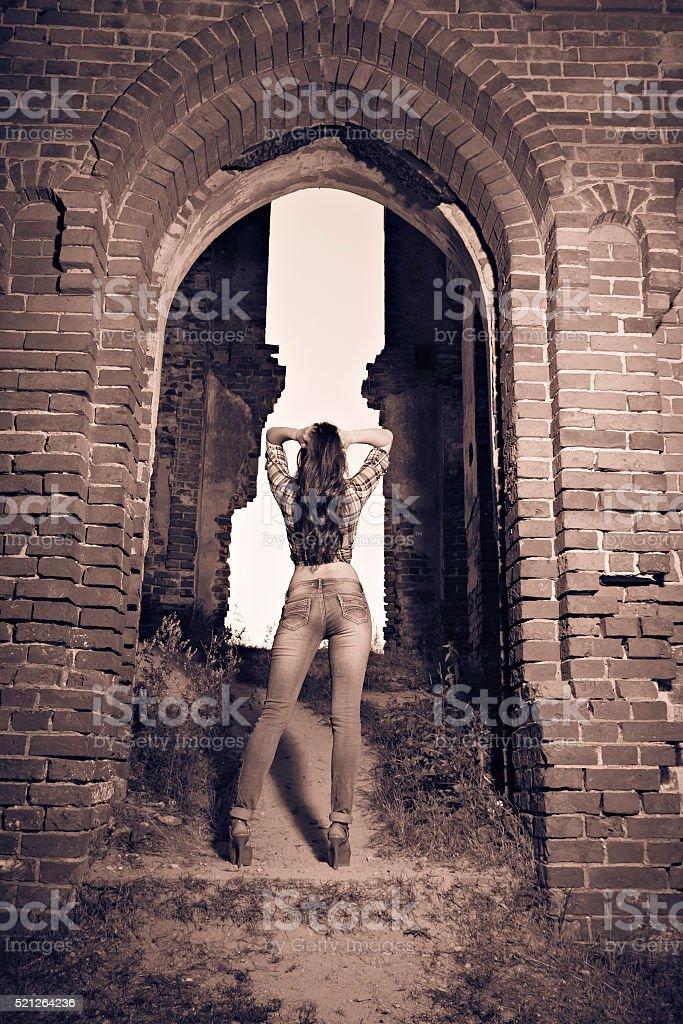 Attractive girl in ruins stock photo