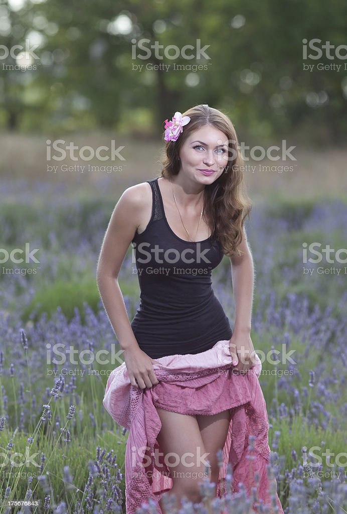 Attractive girl in the field of blossoming lavender royalty-free stock photo