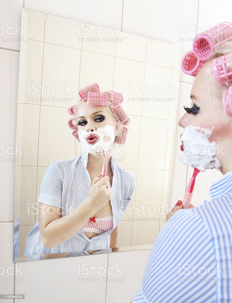 Attractive girl is having a shave royalty-free stock photo