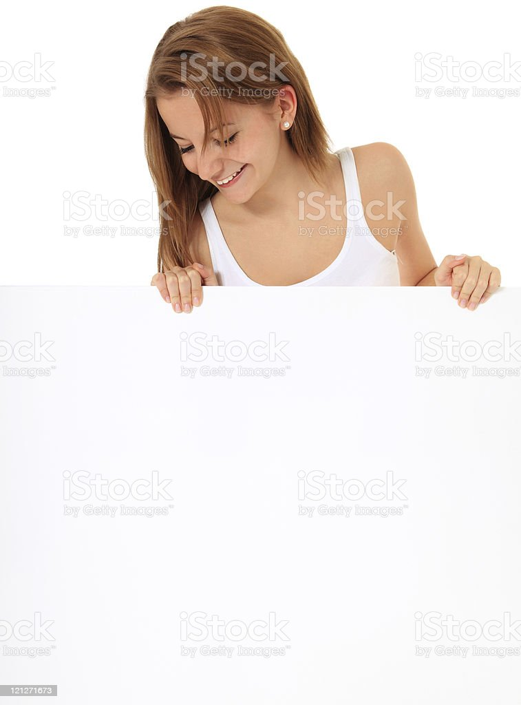Attractive girl looking down blank sign stock photo