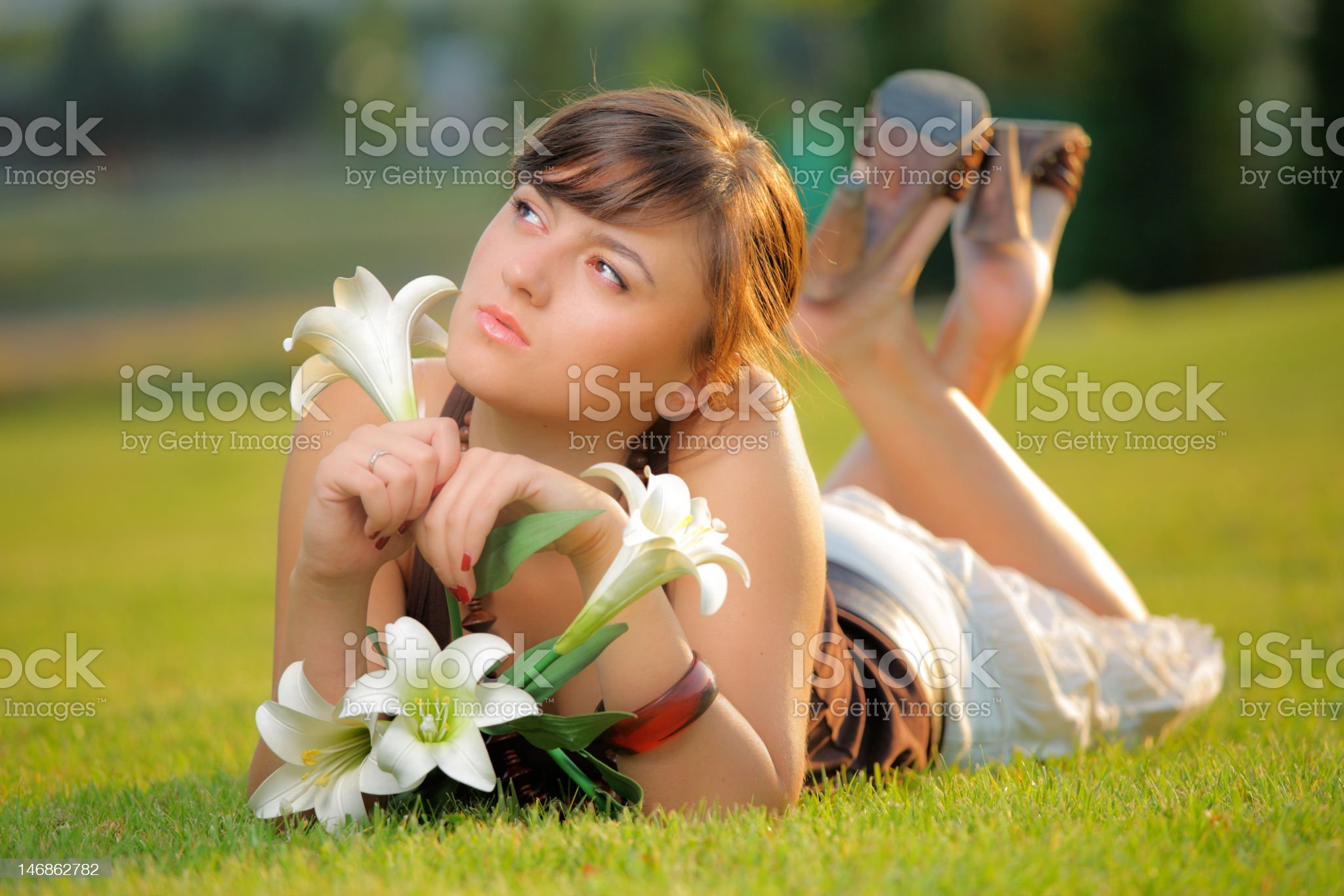 Attractive girl lying on the grass royalty-free stock photo