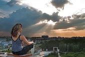 Attractive girl meditating at sunbeam
