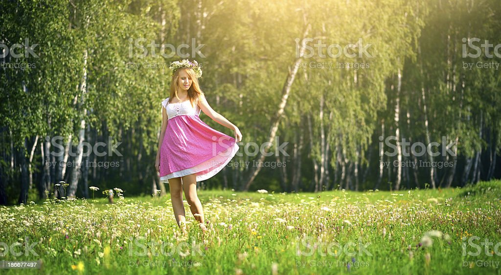 attractive girl on a green meadow royalty-free stock photo