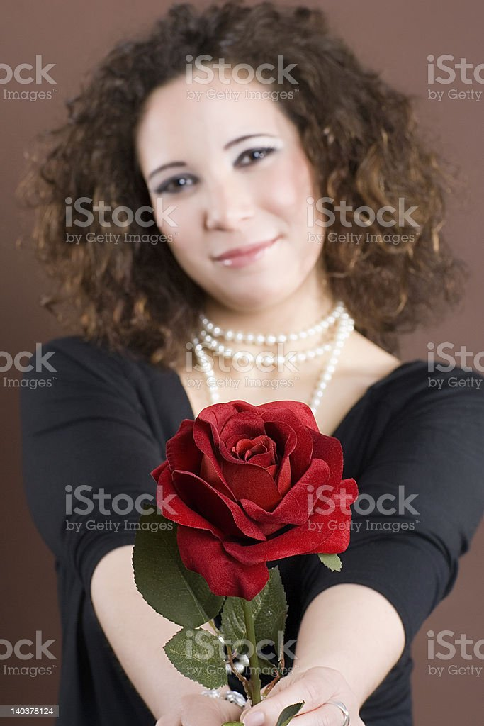 Attractive girl presents you a rose royalty-free stock photo