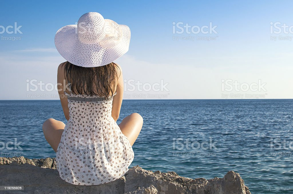 attractive girl relaxing on beach stock photo