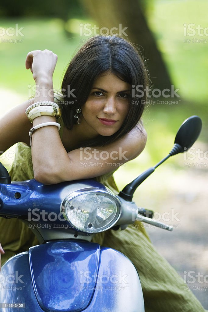 Attractive girl sitting on a motorbike royalty-free stock photo