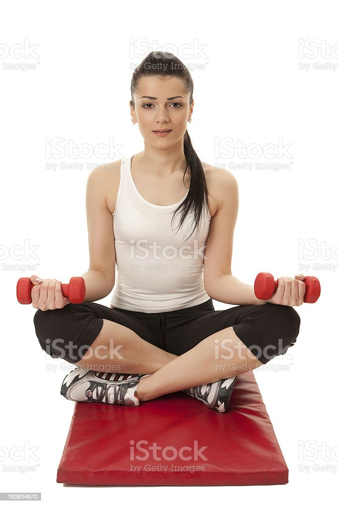 Attractive girl working out - lifting weights royalty-free stock photo