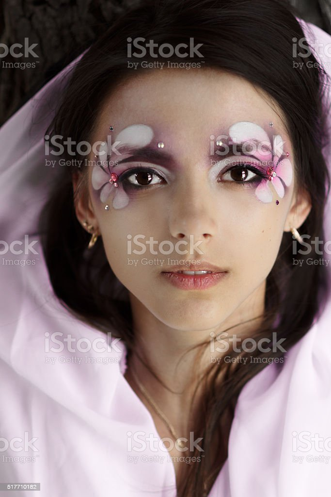 Attractive girl,perfect face with creative,professional makeup with flowers stock photo