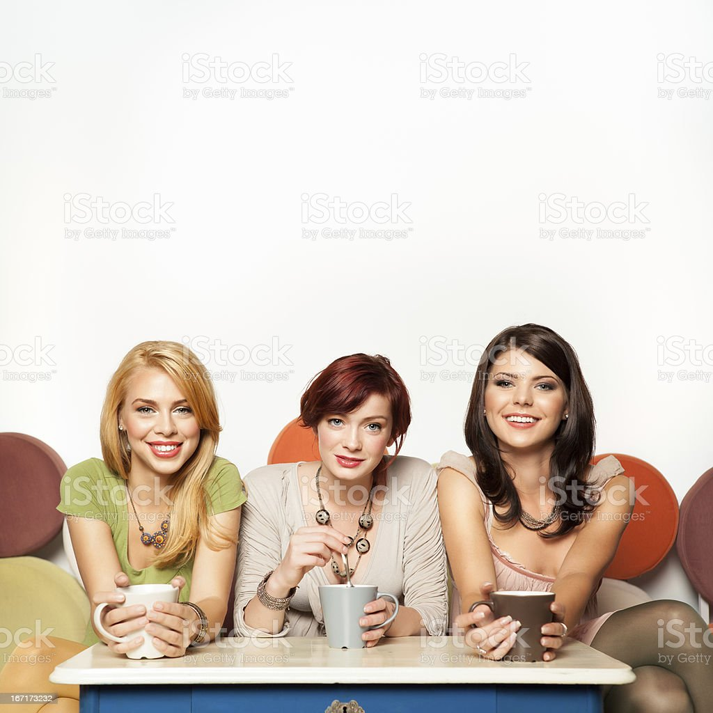attractive girls drinking coffee royalty-free stock photo