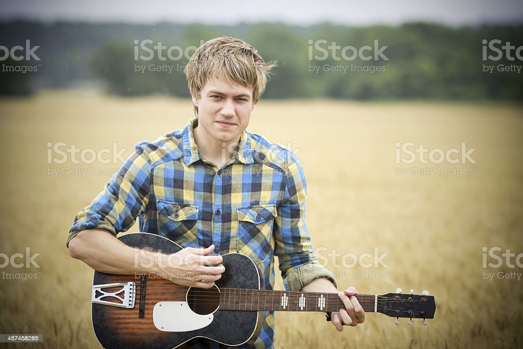 attractive guitar portraits royalty-free stock photo