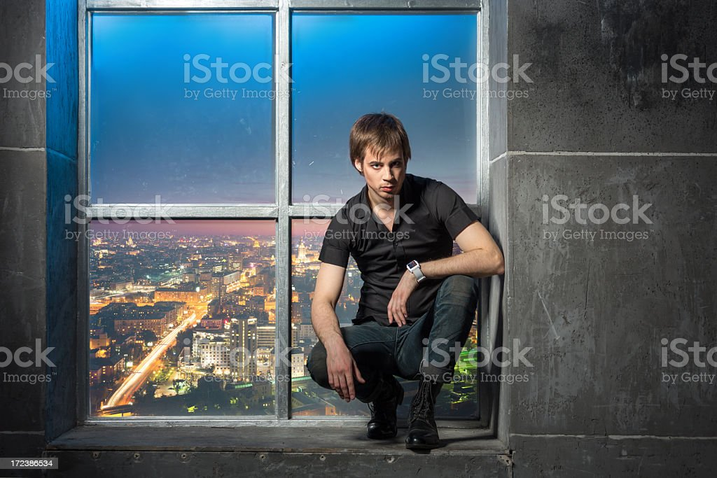 Attractive guy against window royalty-free stock photo