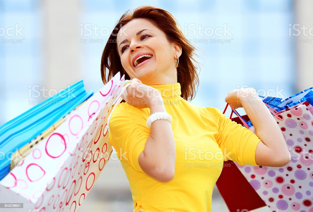 Attractive happy girl out shopping. royalty-free stock photo