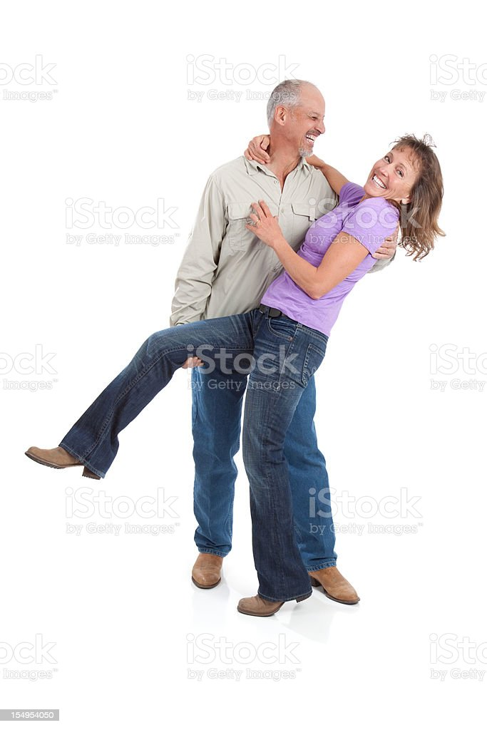 Attractive Happy Mature Couple Dancing on White Background royalty-free stock photo