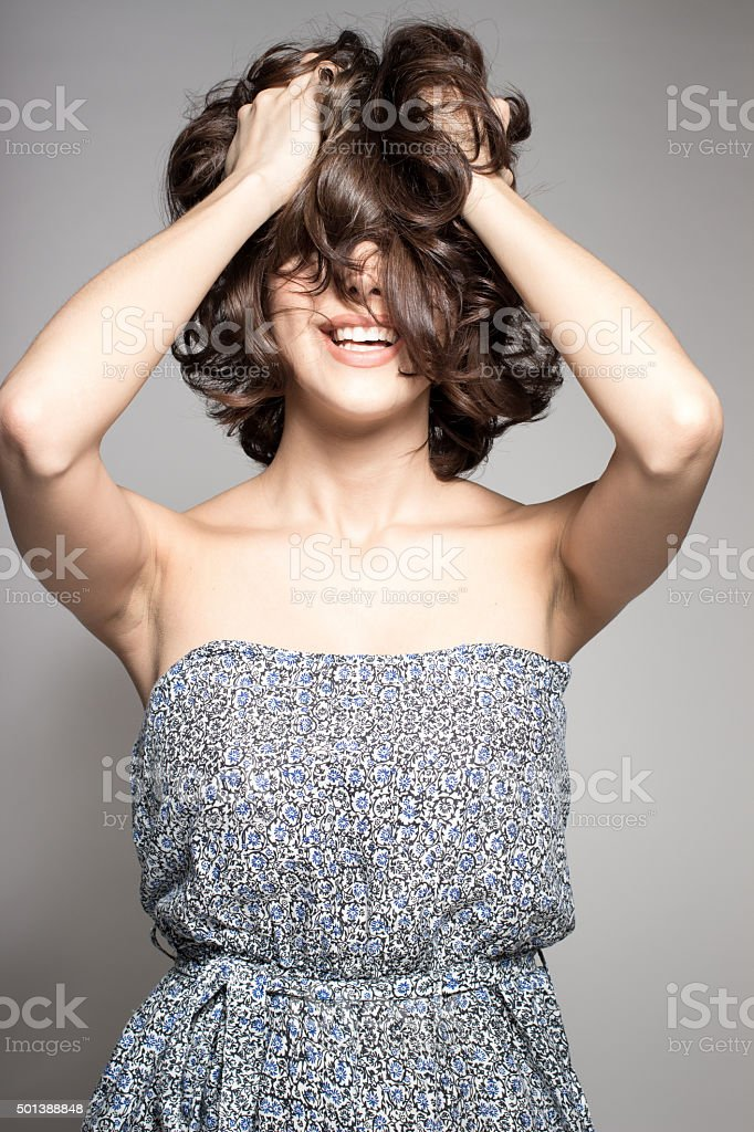 attractive happy sexy female model shaking head with brunette hair stock photo
