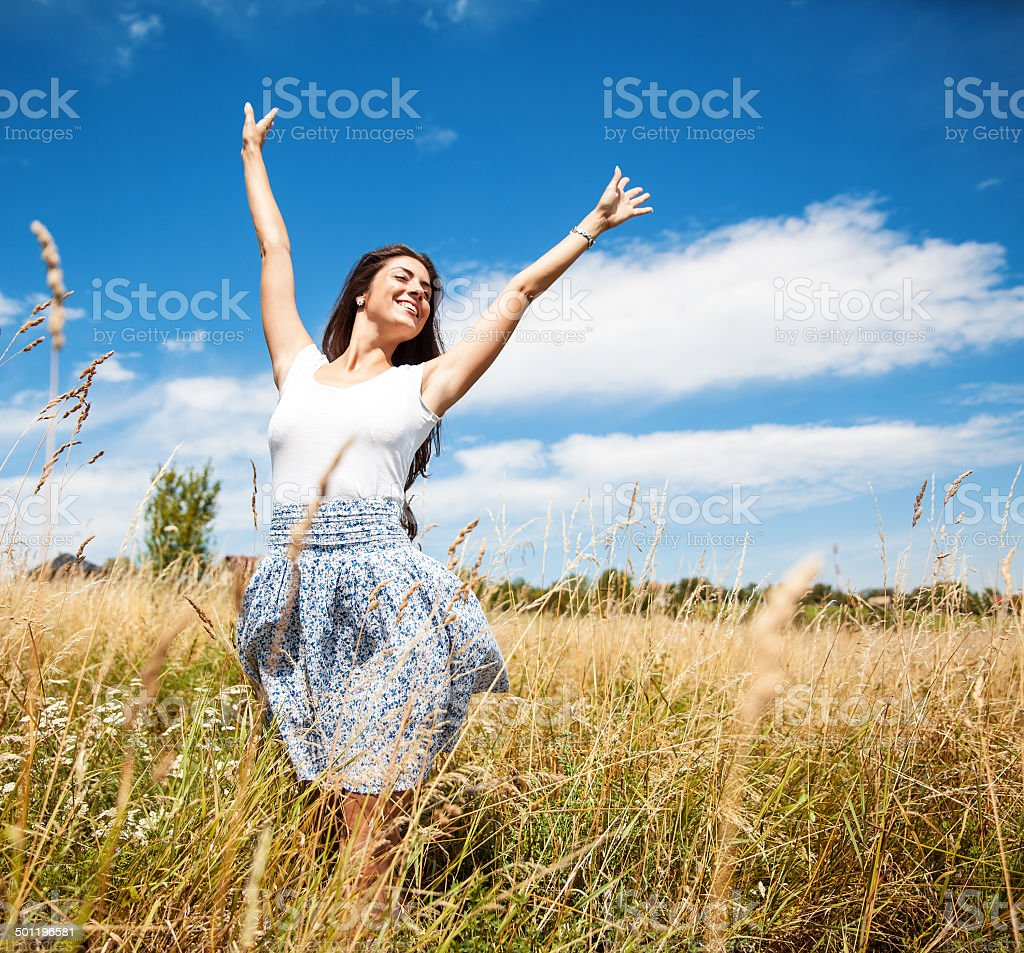 Attractive happy woman in nature. stock photo