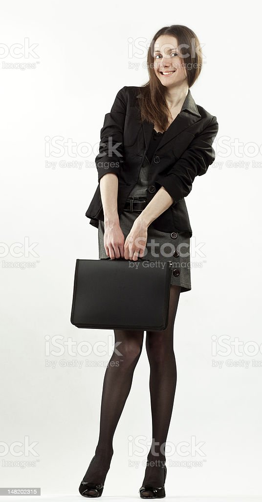 Attractive happy young businesswoman with briefcase royalty-free stock photo