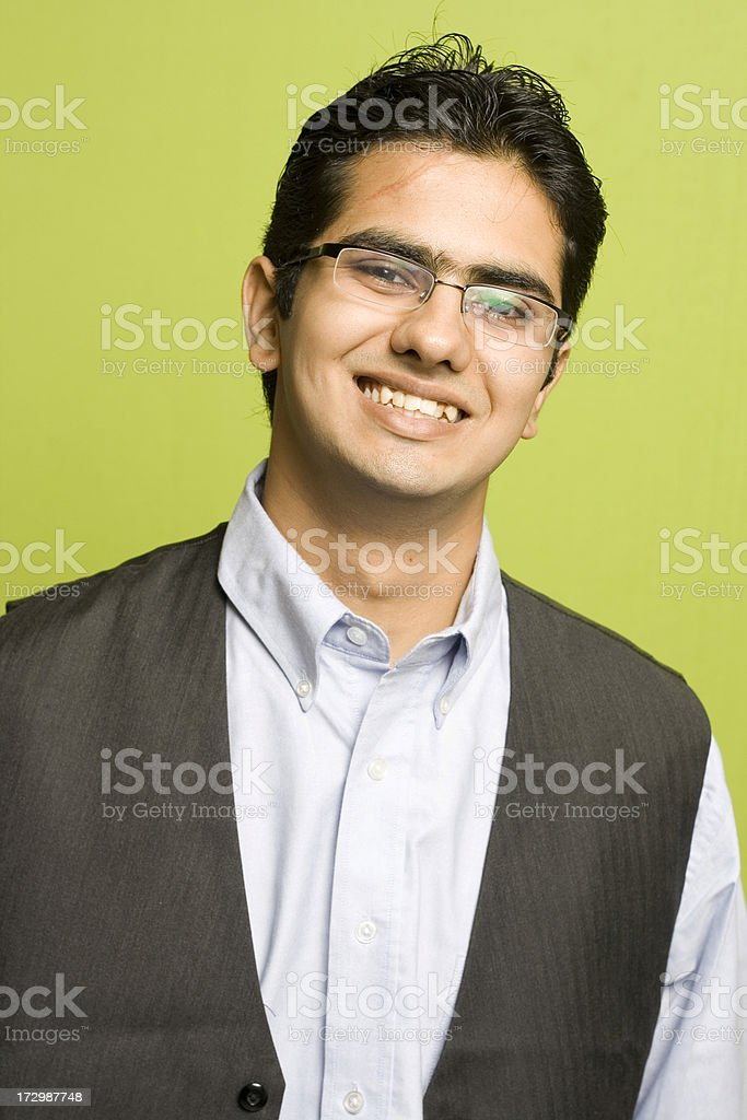 Attractive Happy Young Indian Adult Businessman on Green Background royalty-free stock photo