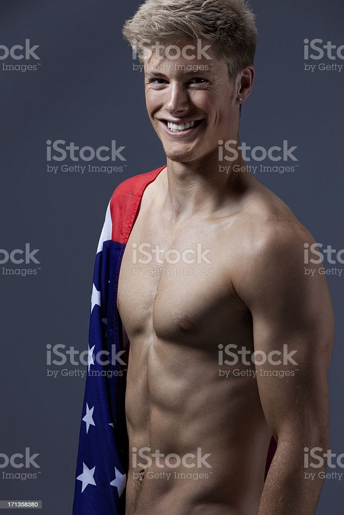 Attractive happy young man with an American flag stock photo