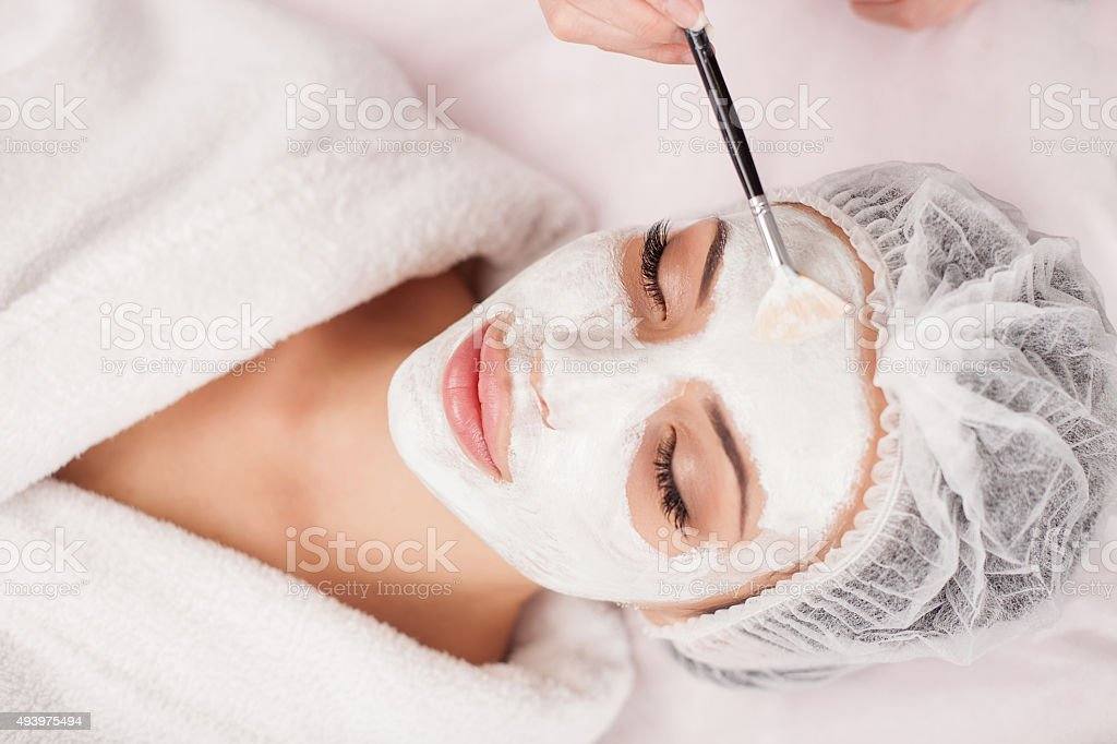 Attractive healthy girl is visiting expert beautician stock photo