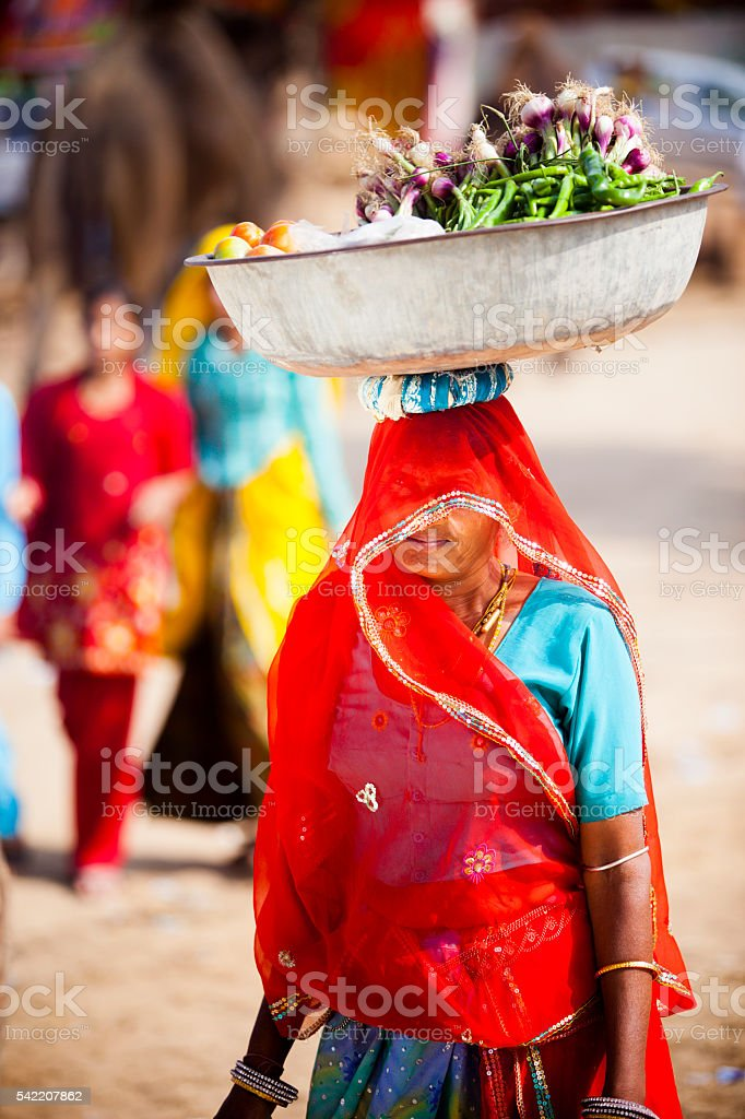 Attractive Indian Woman Carrying Food in Basket on Head stock photo