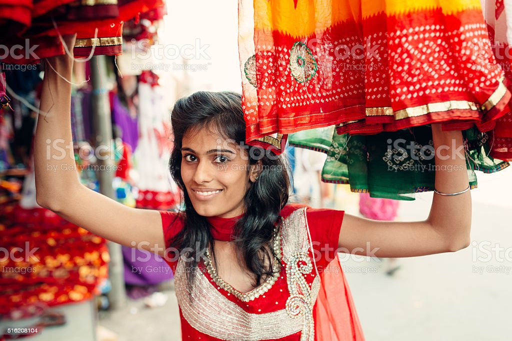 Attractive Indian Woman Shopping in the street stock photo