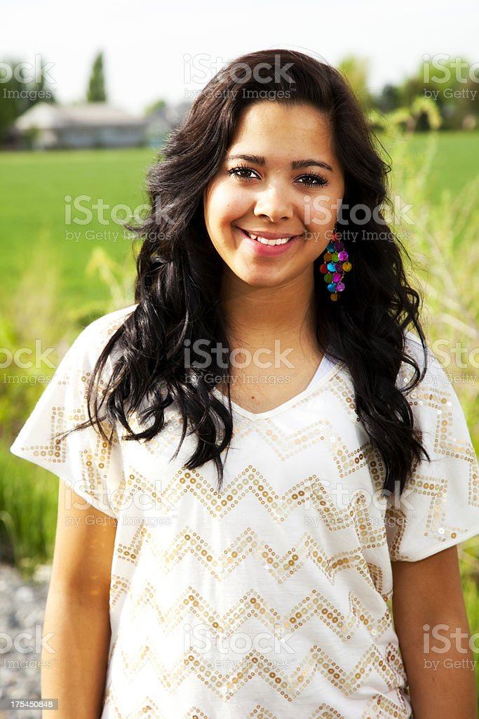 Attractive Latina with Broad Smile in Farm Setting royalty-free stock photo