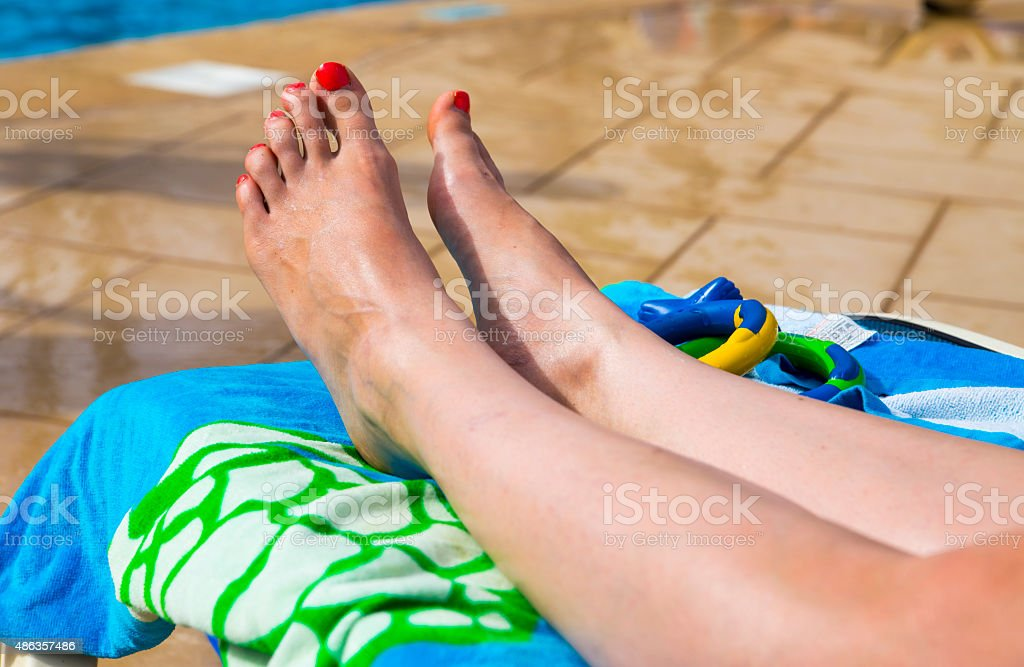 Attractive Legs, Feet and toes on a sunbed royalty-free stock photo