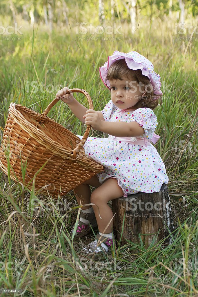 Attractive little girl holding a basket royalty-free stock photo