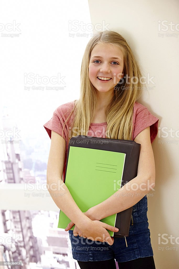 Attractive little girl holding file and folder - Indoors royalty-free stock photo