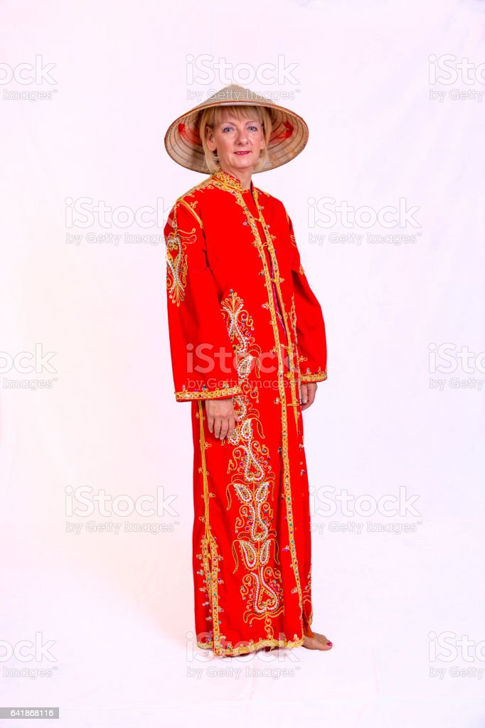 Attractive magician assistant in chinese costume stock photo