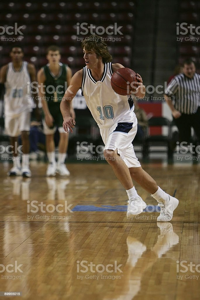 Attractive Male Basketball Player Dribbles in Breakaway Sprint stock photo
