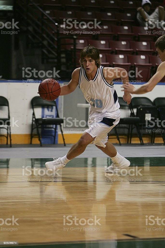 Attractive Male Basketball Player Drives Baseline stock photo