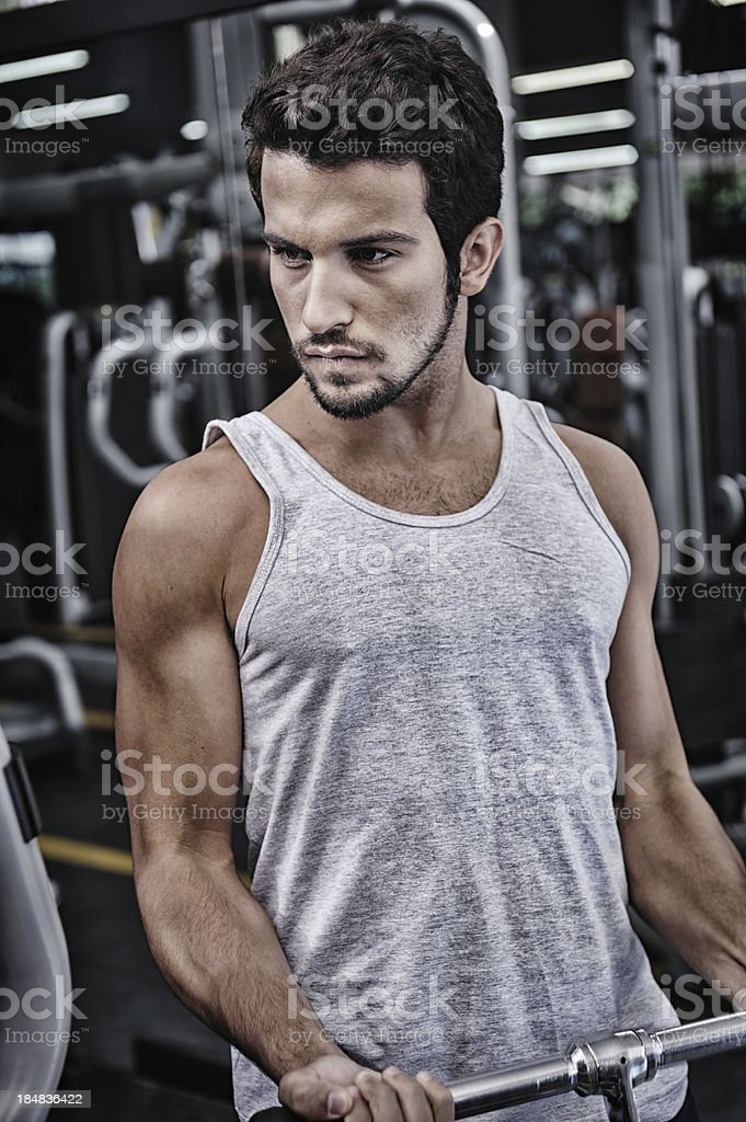 Attractive male lifting weights royalty-free stock photo